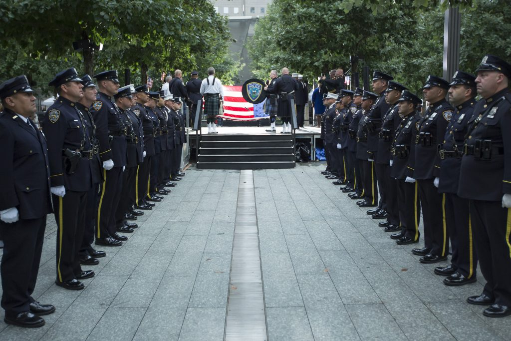PAPD officers provide an honor guard at a 9/11 ceremony.