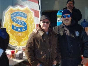 """Rumson Local 345 member Scott Paterson celebrated his 20th plunge at the 27th Polar Bear Plunge in 2020 and plans on doing it until he """"can't walk down the beach."""""""