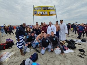South Brunswick Local 166 member Jason Gassman plunged for the 14th consecutive time at the 26th Polar Bear Plunge in 2019.